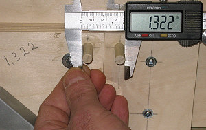 Box joint jig - measuring across the dowels.