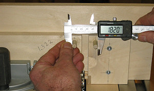 Box joint jig - setting the fence              offset with calipers.