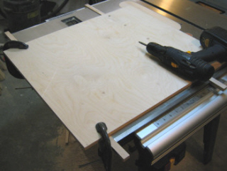 Crosscut sled -  the side runner is clamped              and marked for drilling.