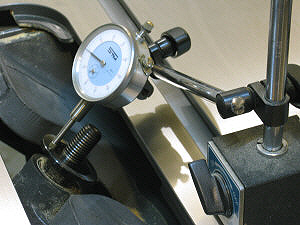 Dial indicator - measuring arbor washer runout on a table saw.