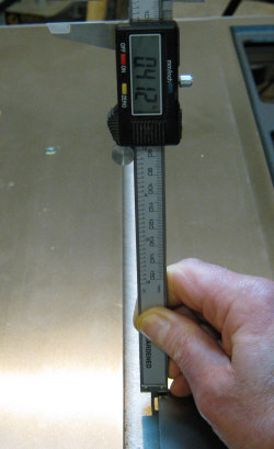 Measuring the depth of my miter slot with digital calipers.