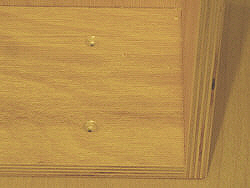 Drawer fronts - countersinking the pilot holes in the drawer box.