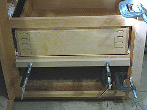 Drawer fronts - straight edges are clamped to the face frame.