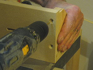 Router table fence - drilling pilot hole for the gussets.