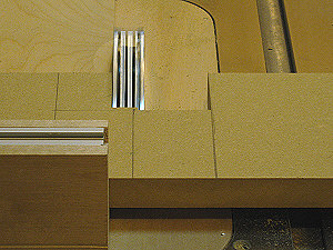Router table fence - cutting out the router bit opening with a dado blade.