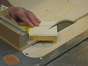 Router table fence - cutting a 45 degree miter on a gusset.