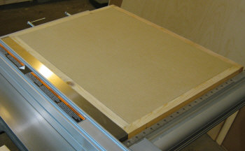 Table saw router table--top is leveled to the height of the outer frame.