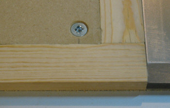Table saw router table top screwed on with countersunk screws.