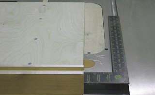 Crosscut sled - Using a framing square to get the fence close.