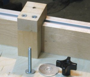 Crosscut sled - Stop block is glued and              screwed together.