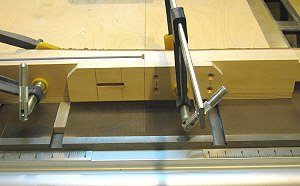 Dado jig - the slotted bracket is clamped to the fence assembly.
