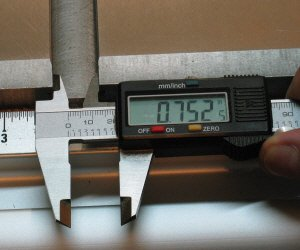 Taking an inside measurement with digital calipers.
