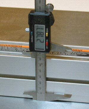 Measuring the height of my fence with digital calipers.