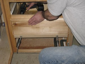 Drawer fronts - driving screws in from inside the drawer box.