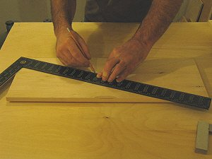Drawer fronts - drawing lines across the diagonals will mark the center of the panel where the lines cross..