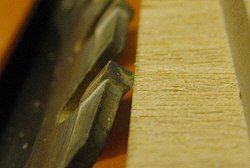 Mitered rabbet - adjusting the blade for the first miter cut.