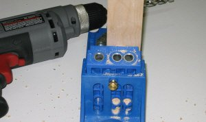 Drilling the holes in hardwood with the pocket hole jig.