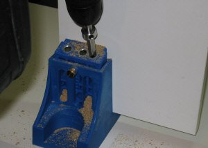 Drilling my first hole with the Kreg pocket hole jig.
