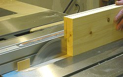 Resawing lumber - ripping the first thinner board free from the workpiece.