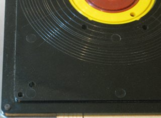 Router insert plate upside down showing the              stepped lip.