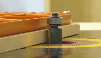 Table saw inserts - setting the flush trim router bit height.