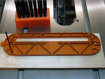 Table saw inserts - marking holes with transfer punch.