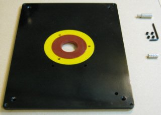 Table saw router table insert with mounting hardware.