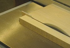 Table saw splitter - Ripping a board with the splitter in place.
