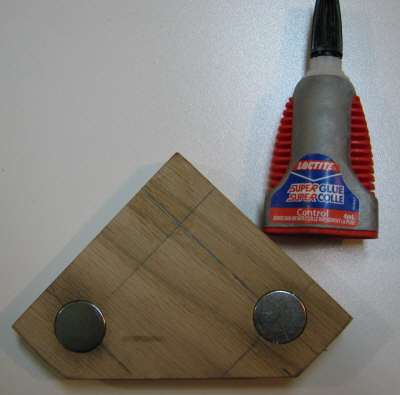 Glue the magnets in the stop block with superglue